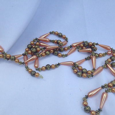 Peach Strand Beads - Themed Rentals - Beautiful bead strands
